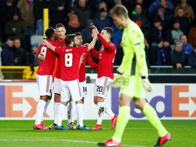 Manchester United's Anthony Martial celebrates scoring their first goal with teammates on February 20, 2020