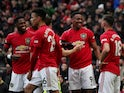 Manchester United's Anthony Martial celebrates scoring their second goal with Bruno Fernandes and teammates on February 23, 2020