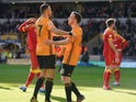 Wolverhampton Wanderers' Diogo Jota celebrates scoring their second goal with Romain Saiss on February 23, 2020