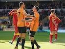 Wolverhampton Wanderers' Diogo Jota celebrates scoring their second goal with Romain Saiss on February 23, 2020