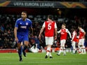 Olympiacos' Youssef El-Arabi celebrates scoring their second goal as Arsenal players look dejected on February 27, 2020