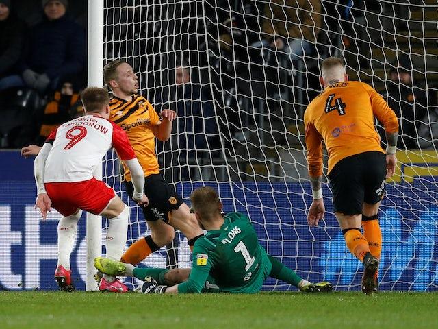 Barnsley's Cauley Woodrow scores their first goal on February 26, 2020