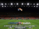 The teams line up before the match in an empty stadium after fans were not allowed in over coronavirus fears at San Siro on February 27, 2020
