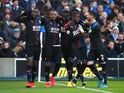 Crystal Palace's Jordan Ayew celebrates scoring their first goal with Christian Benteke, Wilfried Zaha and teammates on February 29, 2020