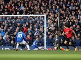 A shot from Everton's Dominic Calvert-Lewin deflects off Manchester United's Harry Maguire into the net before the goal is disallowed for offside against Everton's Gylfi Sigurdsson on March 1, 2020