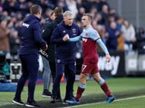 West Ham United's Jarrod Bowen shakes hands with manager David Moyes after being substituted off on February 29, 2020