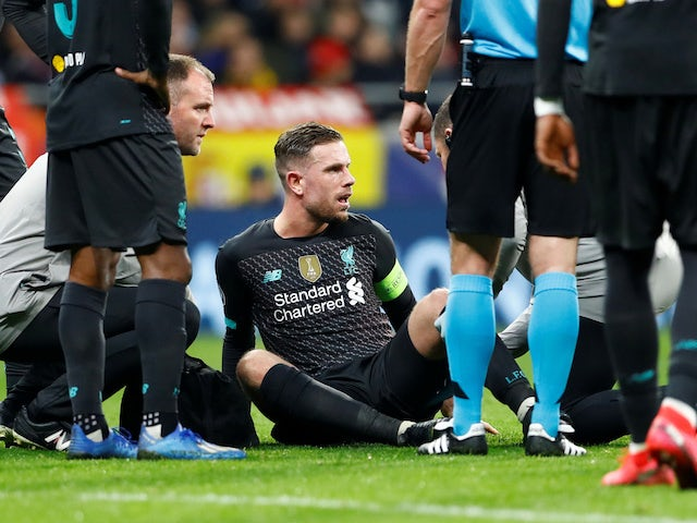 Liverpool's Jordan Henderson receives medical attention after sustaining an injury on February 18, 2020