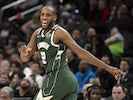 Milwaukee Bucks forward Khris Middleton (22) reacts after making a three point shot during the second half Washington Wizards at Capital One Arena on February 25, 2020
