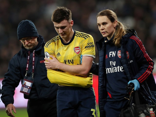 Arsenal's Kieran Tierney is substituted after sustaining a shoulder injury in December 2019