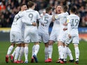 Leeds United's Luke Ayling celebrates with teammates after he scores their first goal on February 29, 2020