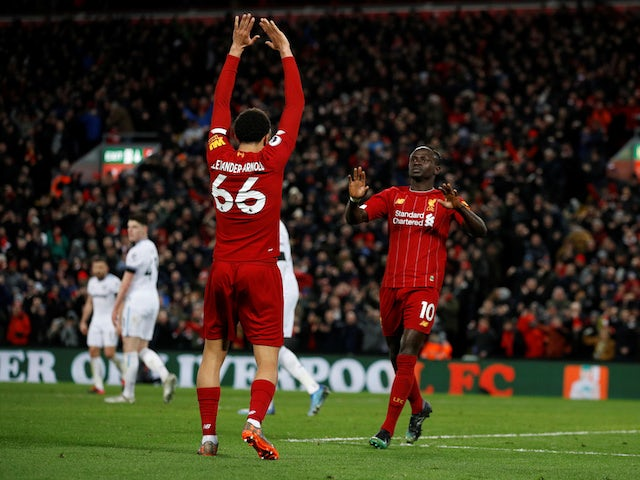 Liverpool's Sadio Mane celebrates scoring their third goal with Trent Alexander-Arnold on February 24, 2020