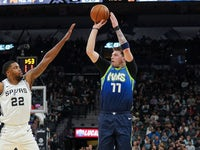 Dallas Mavericks guard Luka Doncic (77) shoots over San Antonio Spurs forward Rudy Gay (22) in the second half at the AT&T Center on February 27, 2020