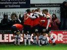 Luton's Martin Cranie celebrates scoring their second goal with teammates on February 25, 2020