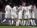 Lyon's Lucas Tousart celebrates scoring their first goal with teammates on February 26, 2020