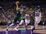 Milwaukee Bucks forward Giannis Antetokounmpo (34) goes to the net after taking a pass against Toronto Raptors forward Chris Boucher (25) at Scotiabank Arena on February 26, 2020