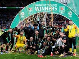 Manchester City players pose with the trophy as they celebrate winning the EFL Cup on March 1, 2020
