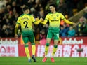 Norwich City's Jamal Lewis celebrates scoring their first goal with Max Aarons on February 28, 2020