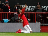Manchester United forward Odion Ighalo celebrates scoring against Club Brugge in the Europa League on February 27, 2020