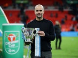 Manchester City manager Pep Guardiola celebrates winning the EFL Cup with the trophy on March 1, 2020