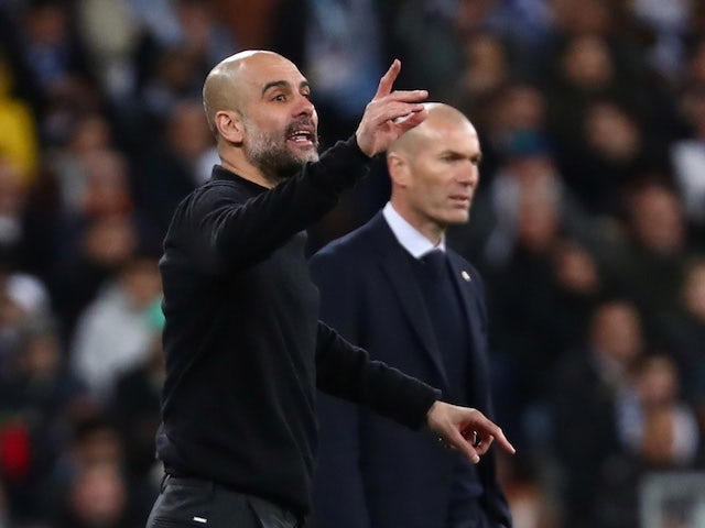 Manchester City manager Pep Guardiola reacts alongside Real Madrid coach Zinedine Zidane on February 26, 2020