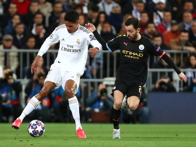 Real Madrid's Raphael Varane in action with Manchester City's Bernardo Silva on February 26, 2020