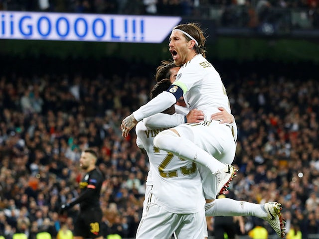 Real Madrid's Isco celebrates scoring their first goal with Vinicius Junior and Sergio Ramos on February 26, 2020