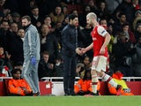 Arsenal's Shkodran Mustafi shakes hands with manager Mikel Arteta as he is substituted off on February 27, 2020