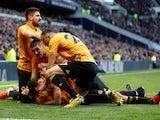 Wolverhampton Wanderers' Raul Jimenez celebrates scoring their third goal with Diogo Jota, Conor Coady, Romain Saiss and Ruben Neves on March 1, 2020