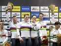 Gold medallists Roy van den Berg, Harrie Lavreysen, Matthijs Buchli and Jeffrey Hoogland of the Netherlands celebrate on the podium on February 26, 2020