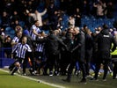 Sheffield Wednesday's Steven Fletcher celebrates with teammates after scoring their first goal on February 26, 2020