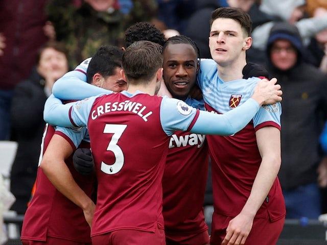 West Ham United's Michail Antonio celebrates scoring their third goal with Declan Rice and teammates on February 29, 2020