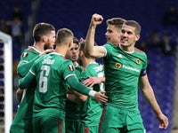 Wolverhampton Wanderers' Matt Doherty celebrates scoring their second goal with Conor Coady and teammates on February 27, 2020