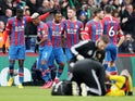 Crystal Palace's Jordan Ayew celebrates scoring their first goal with teammates on March 7, 2020