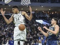 Milwaukee Bucks forward Giannis Antetokounmpo (34) reacts after dunking against Indiana Pacers forward Doug McDermott (20) in the fourth quarter at Fiserv Forum on March 5, 2020