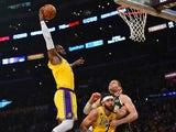 Los Angeles Lakers forward LeBron James (23) moves in for a dunk as center JaVale McGee (7) provides coverage against Milwaukee Bucks center Brook Lopez (11) during the first half at Staples Center on March 7, 2020