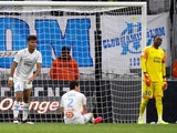 Marseille players look dejected after conceding late on against Amiens in Ligue 1 on March 6, 2020