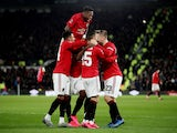 Manchester United's Odion Ighalo celebrates scoring their third goal with Manchester United's Fred and teammates on March 5, 2020