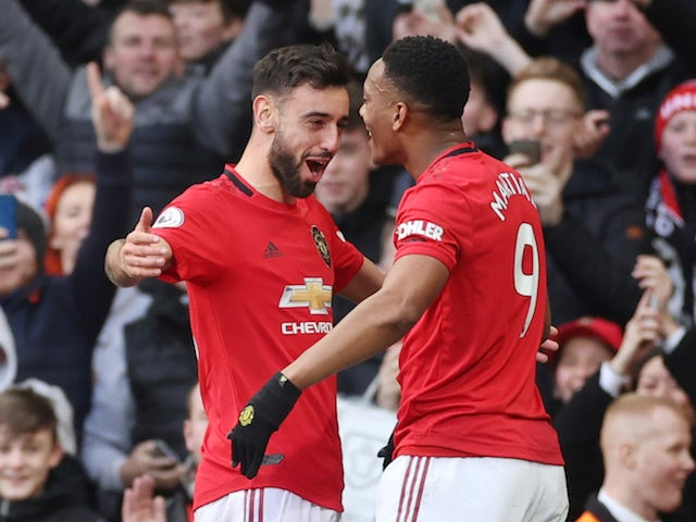Manchester United's Anthony Martial celebrates scoring their first goal with Bruno Fernandes on March 8, 2020