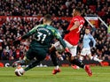 Manchester United's Anthony Martial in action with Manchester City's Ederson on March 8, 2020