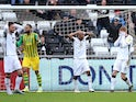 Swansea City's Jay Fulton (right) reacts after putting a shot wide on March 7, 2020