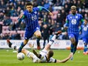 Wigan Athletic's Leon Balogun in action with Luton Town's James Collins on March 7, 2020