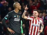 Atletico Madrid's Saul Niguez celebrates scoring their first goal as Liverpool's Fabinho looks dejected on February 18, 2020
