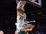 Denver Nuggets guard Jamal Murray (27) finishes off a basket over Milwaukee Bucks forward D.J. Wilson (5) in the third quarter at the Pepsi Center on March 10, 2020