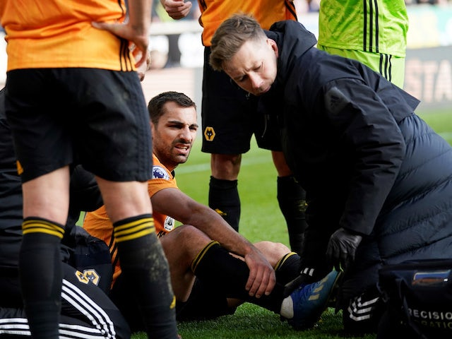 Wolverhampton Wanderers' Jonny receives medical attention after sustaining an injury in February 2020