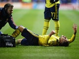 Arsenal's Lucas Torreira reacts after sustaining an injury in March 2020