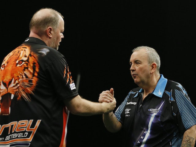 Raymond Van Barneveld overcomes old rival Phil Taylor in charity match
