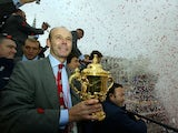 England coach Clive Woodward, holding the William Webb Ellis trophy, accompanies the 2003 Rugby World Cup squad as they arrive in Trafalgar Square at the end of their parade through the capital to mark the team's victory, in London, Britain, December 8, 2