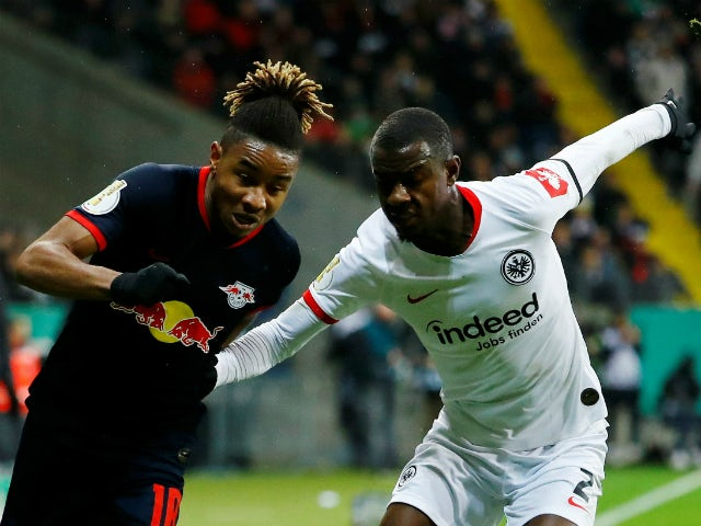 RB Leipzig's Christopher Nkunku in action with Eintracht Frankfurt's Evan Ndicka in February 2020