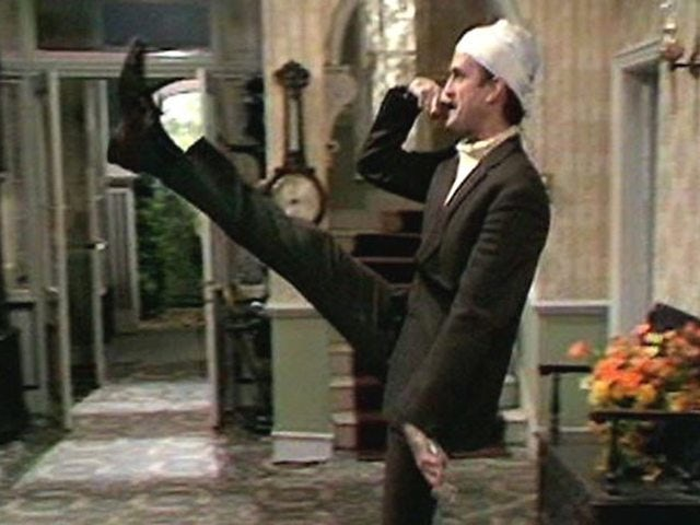 John Cleese as Basil Fawlty in Fawlty Towers