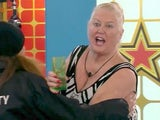 Kim Woodburn is restrained from attacking Jamie O'Hara in January 2017